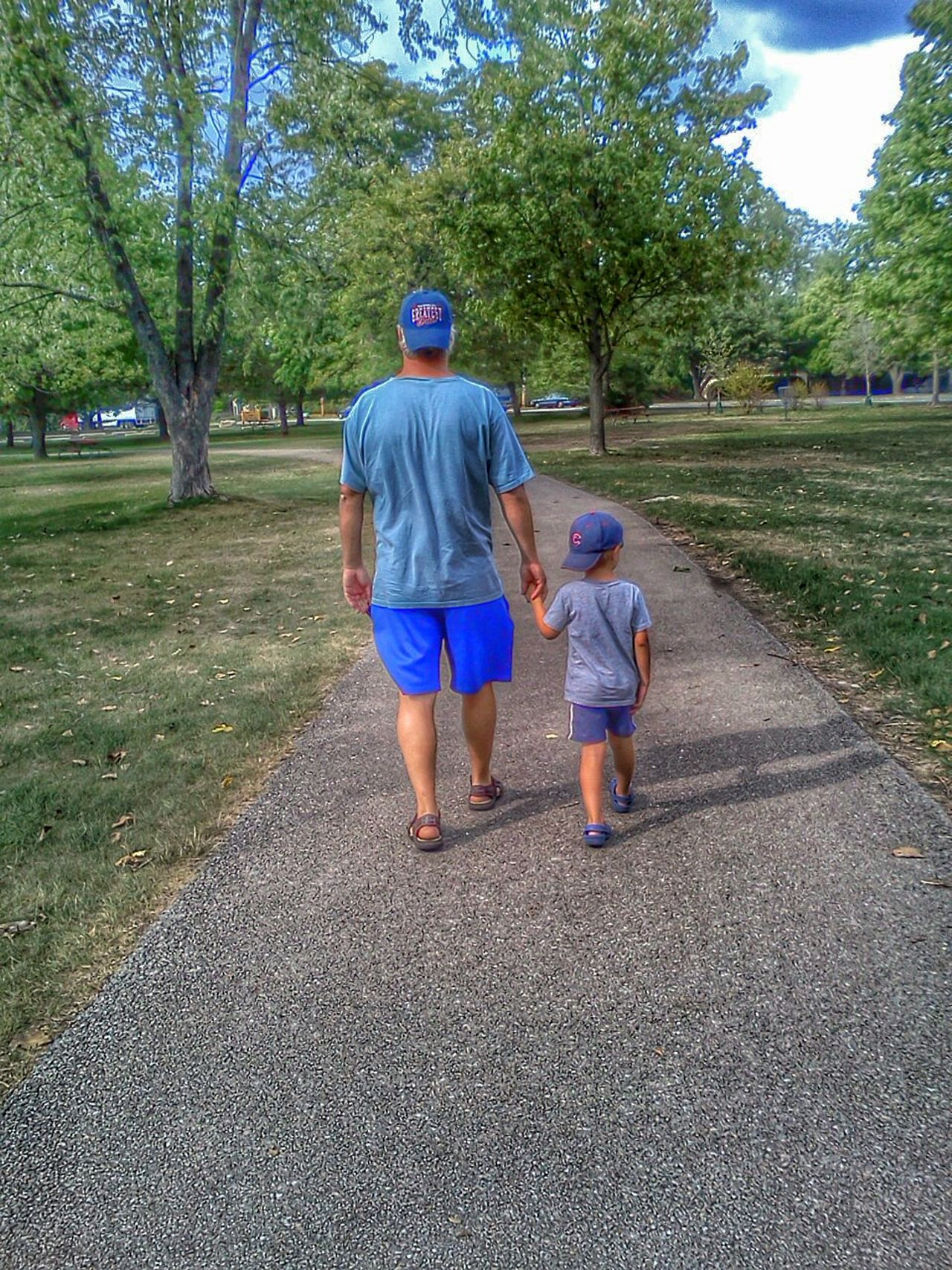 Father and son walkingvin a park Children Photography My Child Family Walks My Kid Color Photography Childhood Memories Color Kids Portrait People Editorial  Childhood Outdoors Walking Hand In Hand Father & Son Dad And Son Father And Son ChildrenSummer Colorful Boy Fatherhood Moments Fatherhood  Park Colors