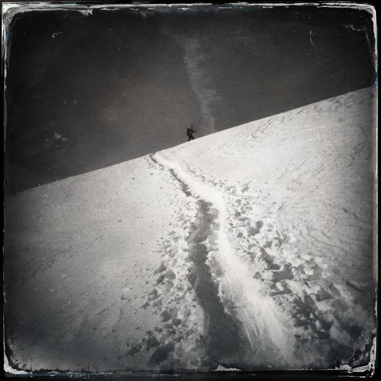 The path in the snow leading up the mountain Hipstamatic The_guido Blackandwhite