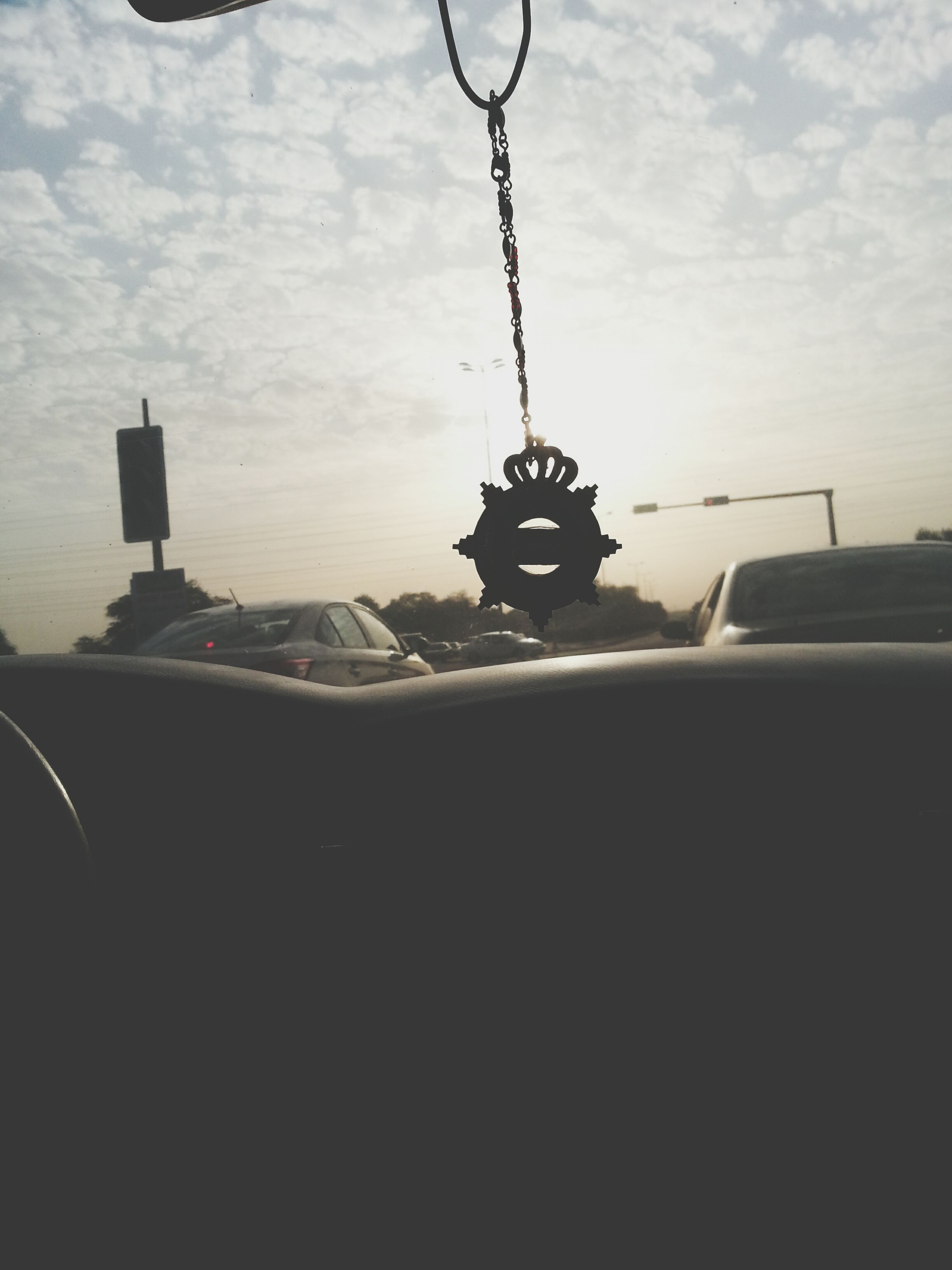 sky, transportation, cloud - sky, mode of transport, lighting equipment, hanging, no people, sea, water, cloud, tranquility, nature, outdoors, close-up, car, part of, metal, street light, scenics, sunset