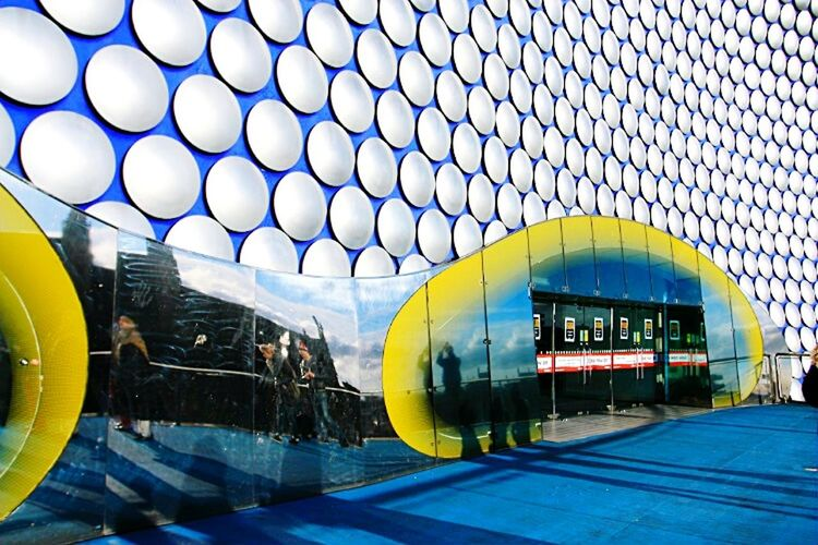 A door of Birmingham bull ring shopping mall. Like people's shadow on the windows.Birmingham Bull Ring Shopping Mall Silver  Door On The Road Colorful Circles Precision EyeEmBestPics