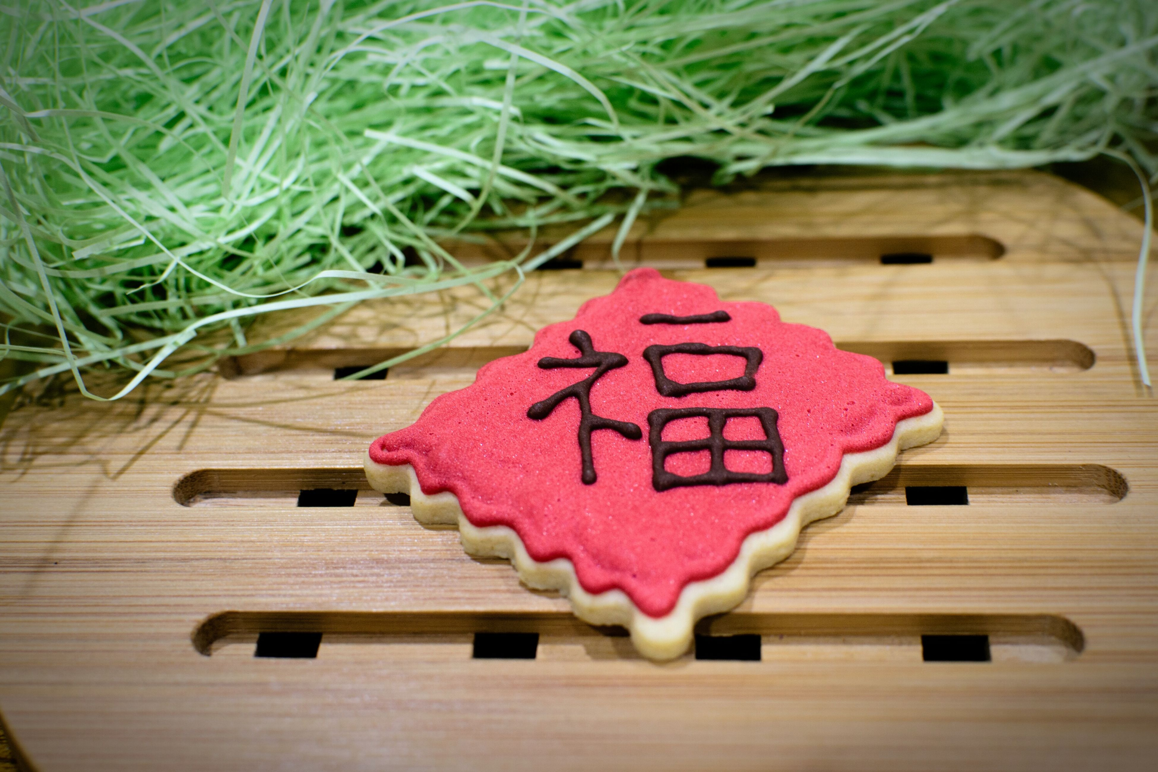close-up, heart shape, love, text, western script, still life, communication, table, wood - material, paper, indoors, red, pink color, celebration, high angle view, no people, creativity, sweet food, art and craft, capital letter