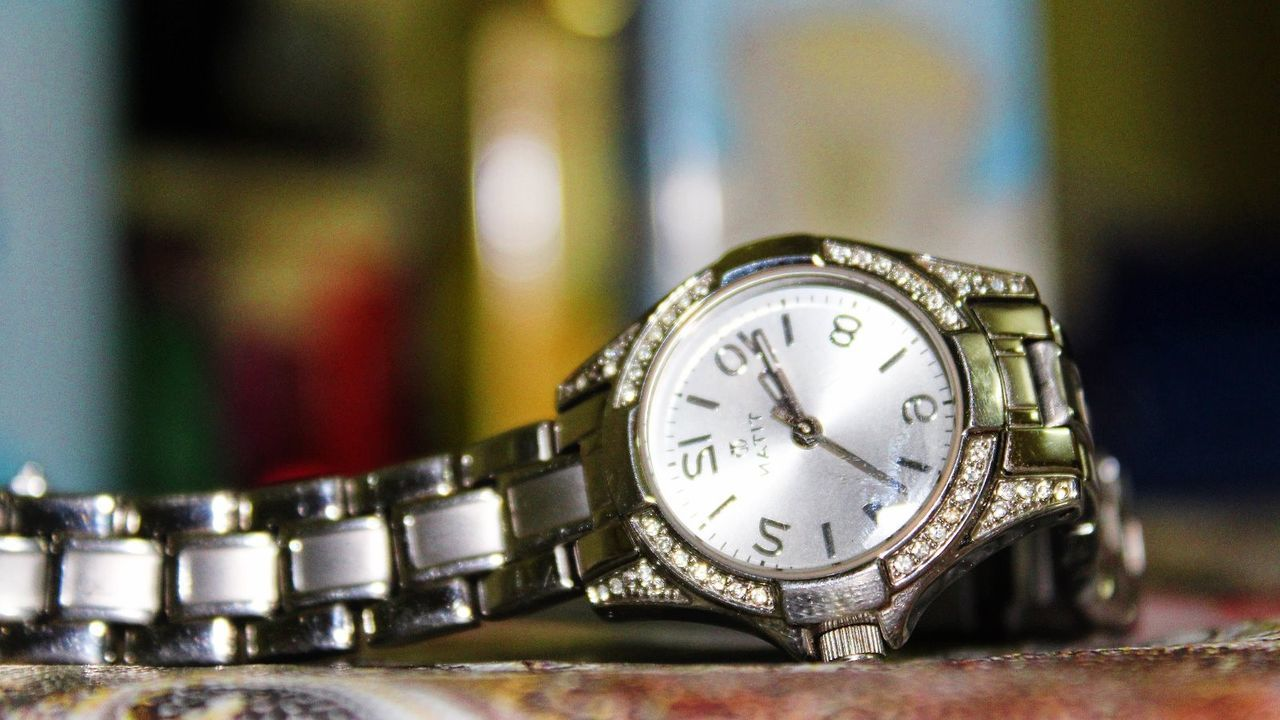 time, silver colored, metal, single object, close-up, indoors, table, watch, focus on foreground, no people, antique, old-fashioned, wristwatch, clock, day, minute hand, clock face