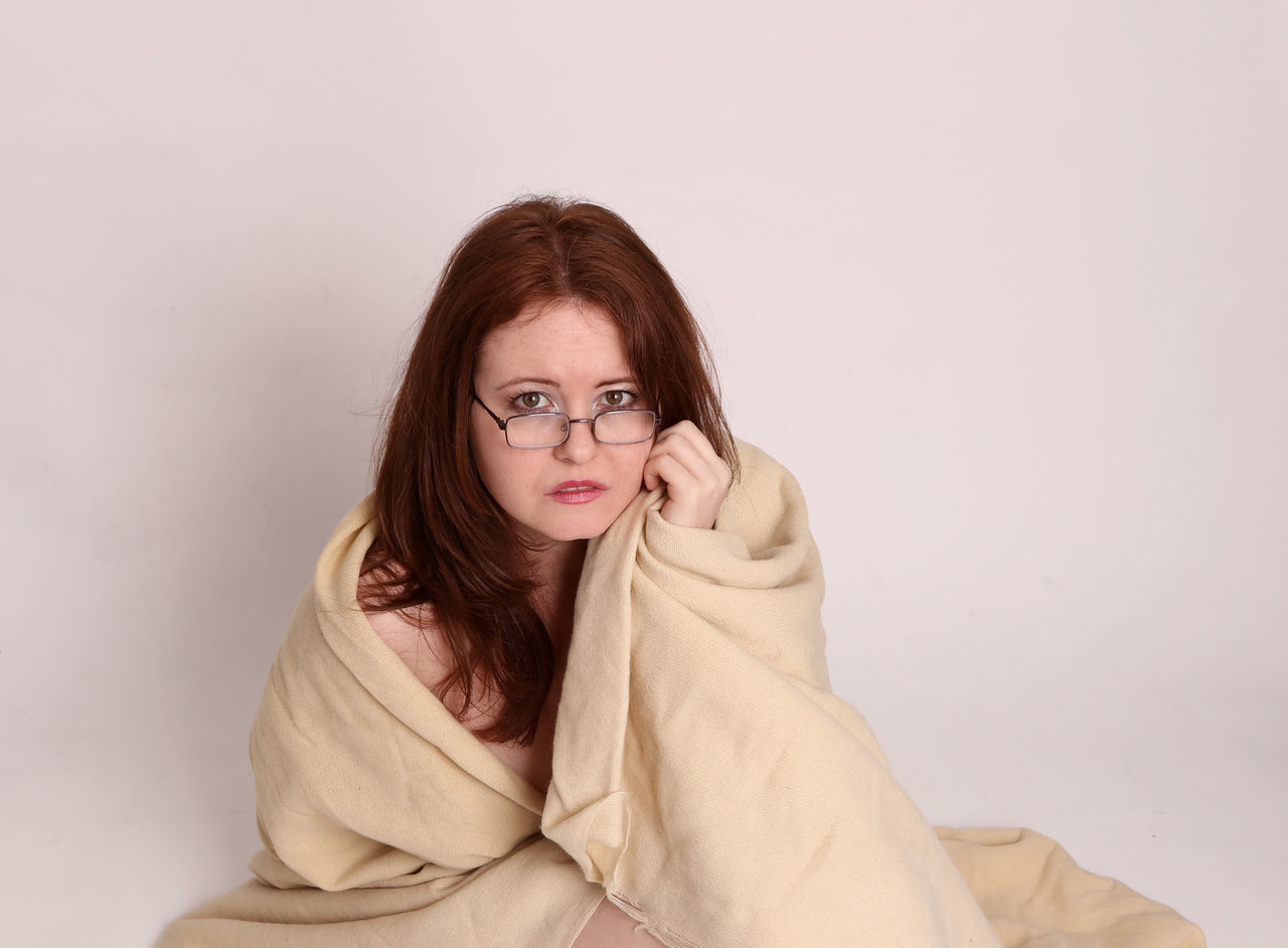 one person, real people, young adult, looking at camera, eyeglasses, young women, front view, white background, portrait, redhead, lifestyles, leisure activity, studio shot, beautiful woman, casual clothing, happiness, standing, smiling, warm clothing, day