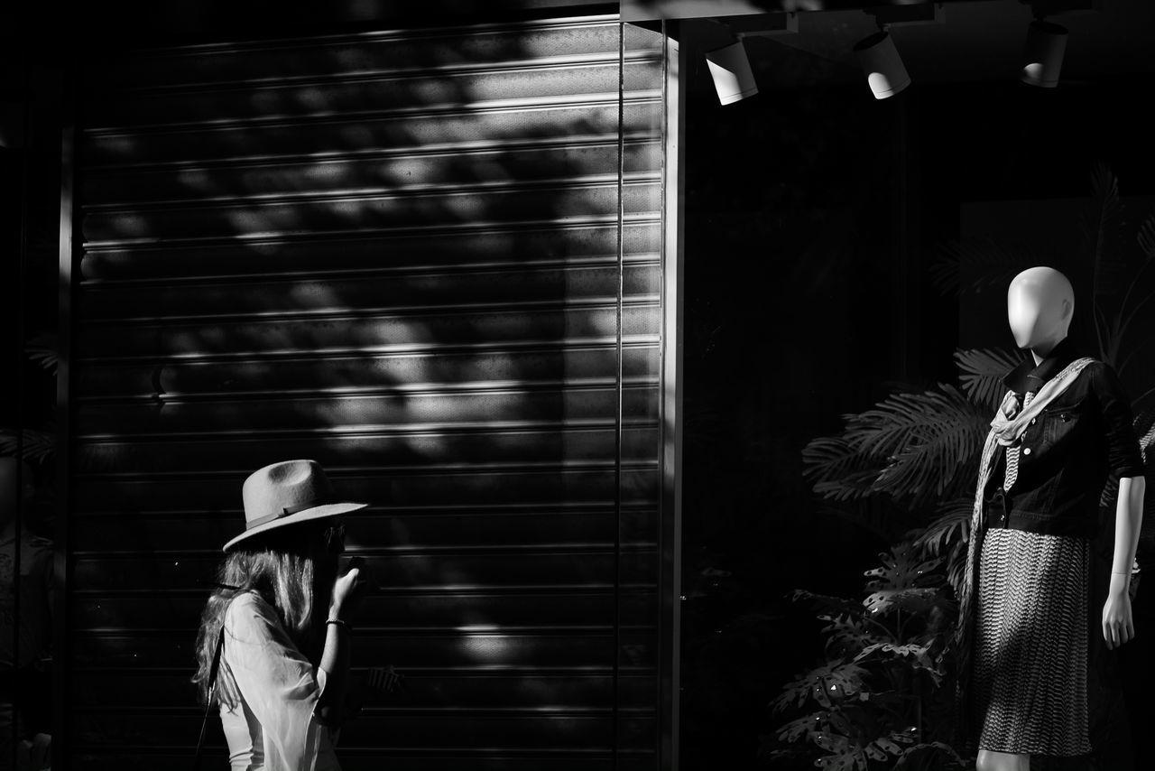The hat Day Horizontal Lifestyles Light And Shadow Manequin Monochrome Photography One Person Outdoors People Person Real People Storefront Tourist