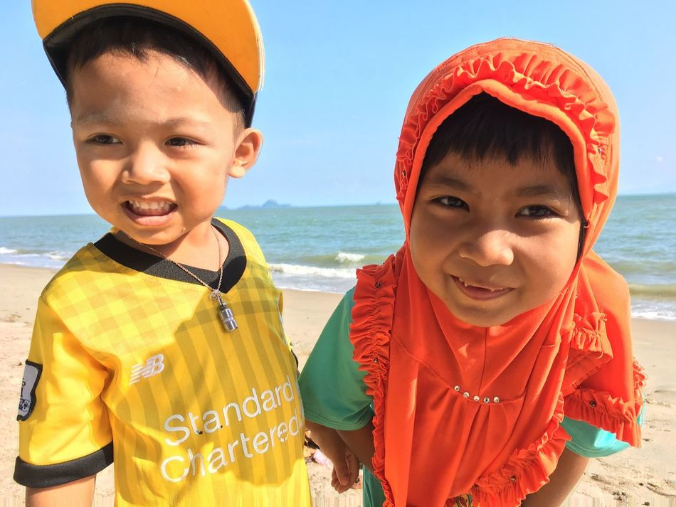 Real People Childhood Boys Sea Looking At Camera Two People Beach Water Happiness Smiling Sky