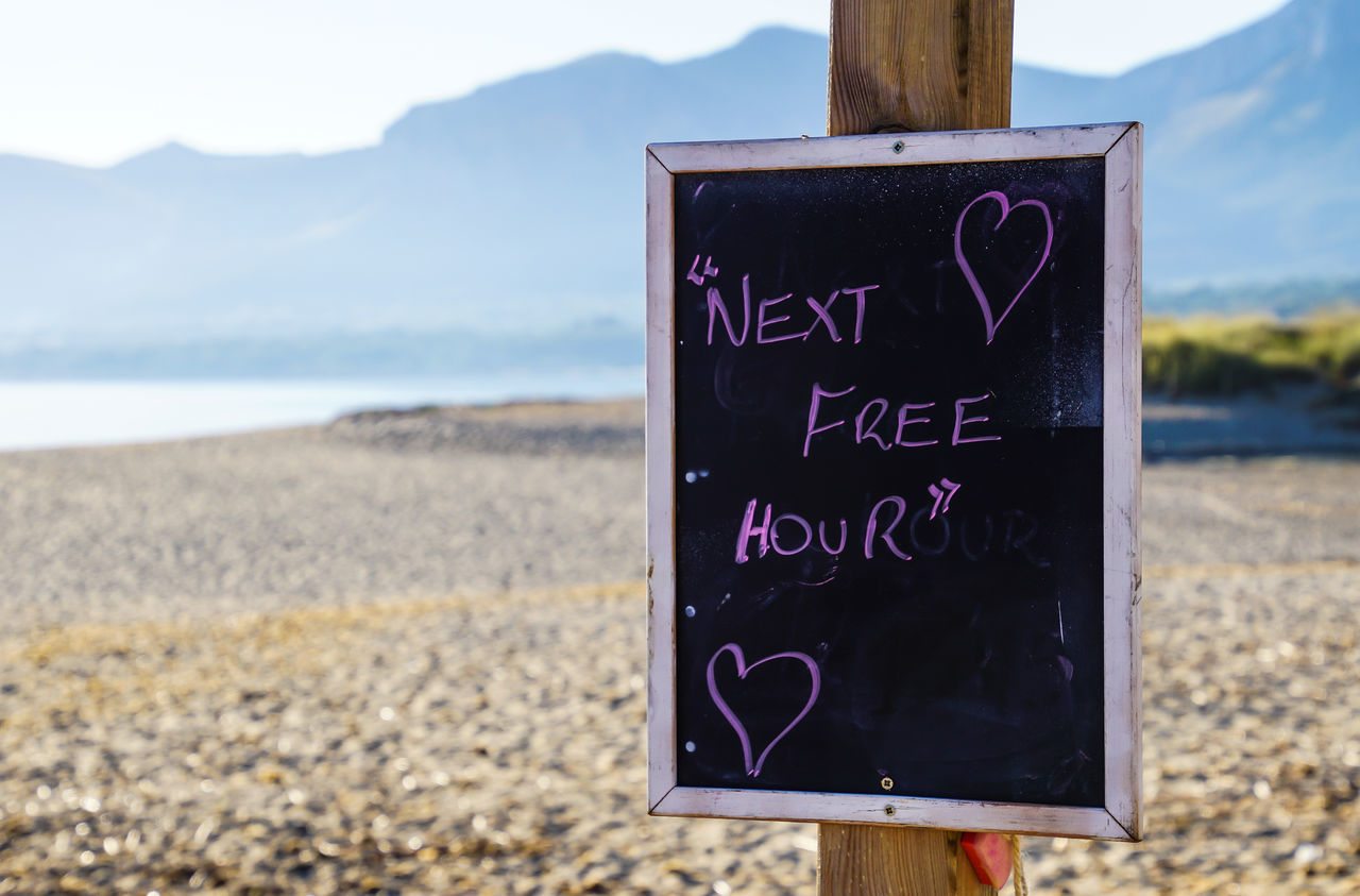 Beach Beauty In Nature Blackboard  Close-up Communication Day Focus On Foreground Hanging Love Message Mountain Mountains Nature No People Open Sign Outdoors Scenics Sea Sky Son Serra De Marina Text Water