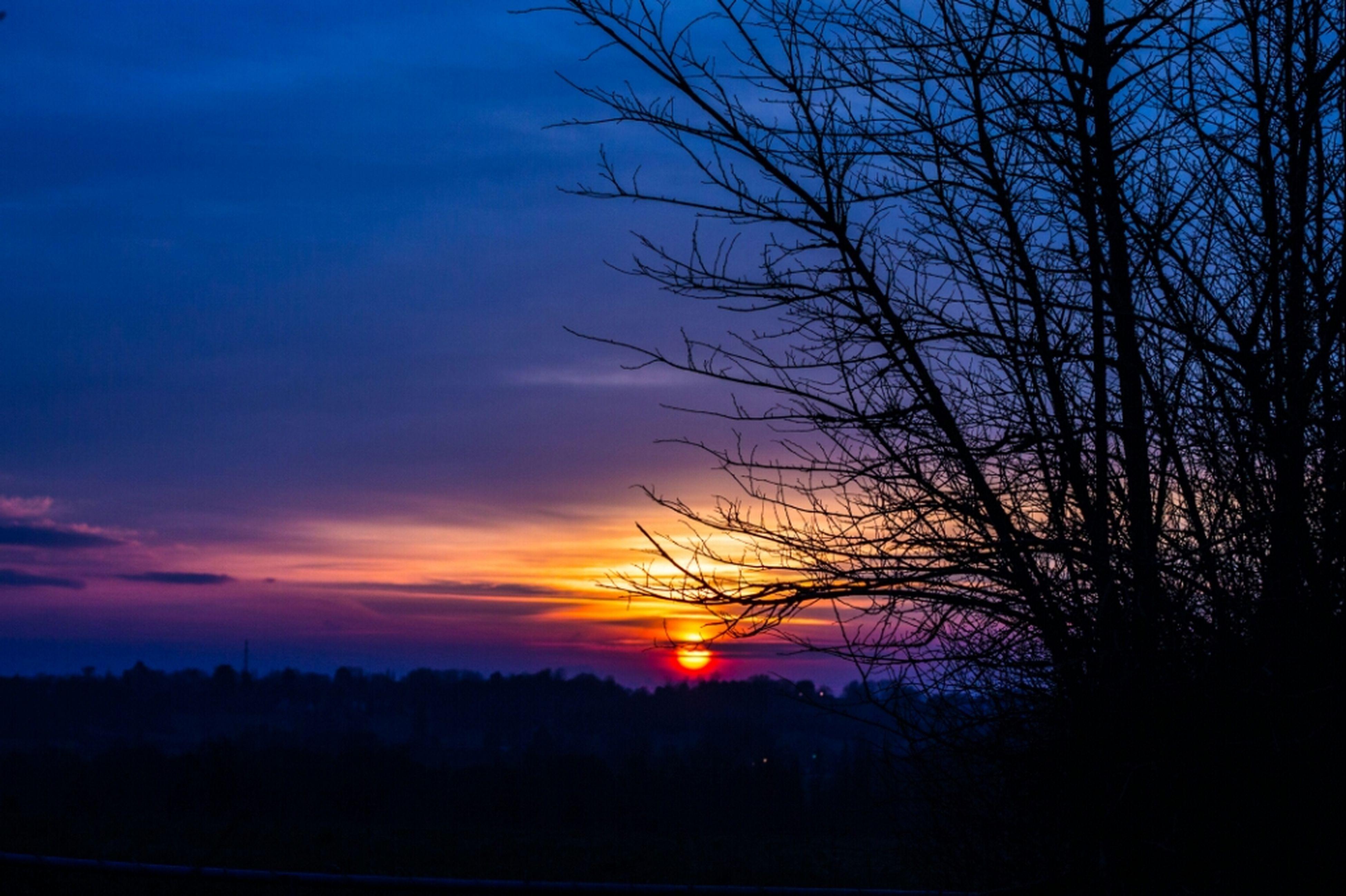sunset, silhouette, tranquil scene, scenics, tranquility, beauty in nature, sky, sun, tree, orange color, nature, idyllic, bare tree, cloud - sky, landscape, sunlight, dark, majestic, cloud, dramatic sky