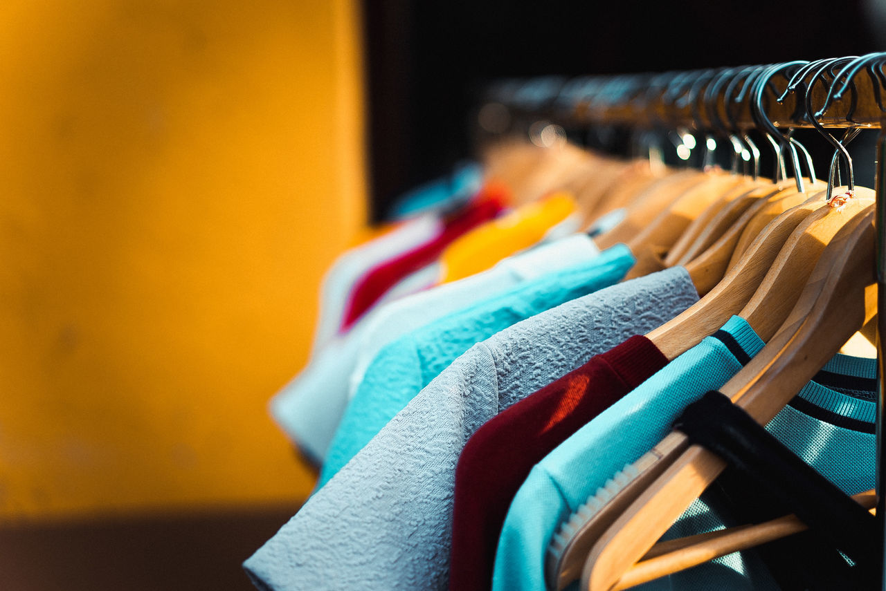 multi colored, clothing, fashion, choice, variation, retail, clothing store, hanging, store, large group of objects, clothes rack, business, boutique, indoors, consumerism, no people, close-up