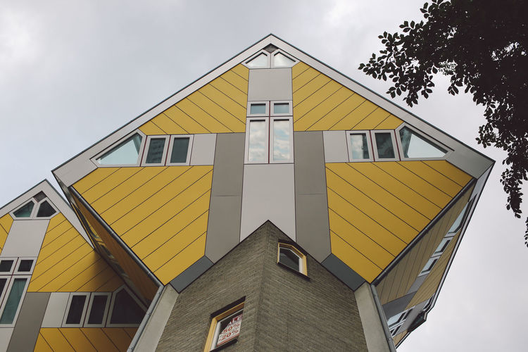 Architecture Building Exterior Building Feature Built Structure City Cloud - Sky Cubic Houses Day Façade House Housing Development International Landmark Low Angle View No People Outdoors Residential Building Sky Window Yellow