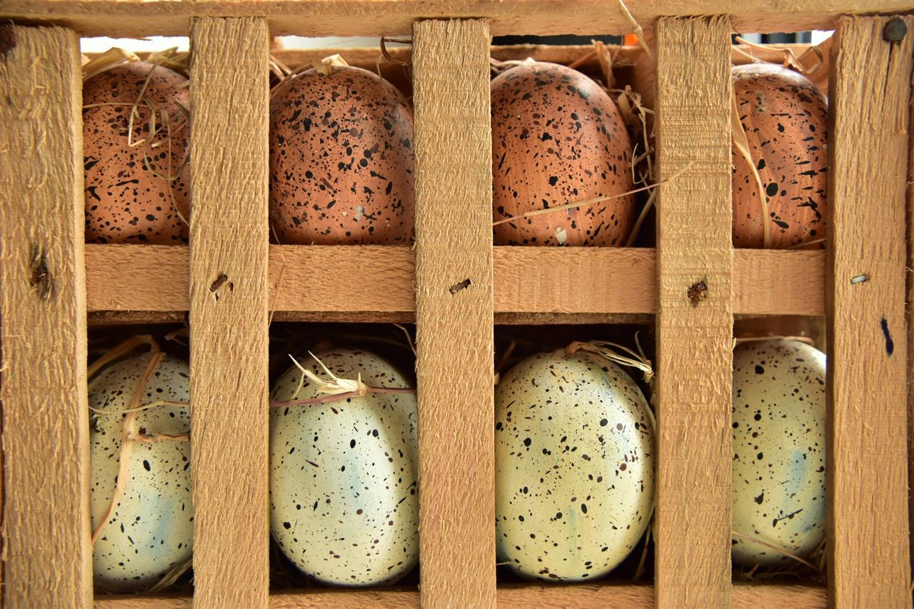 Close-Up Of Easter Eggs In Crate
