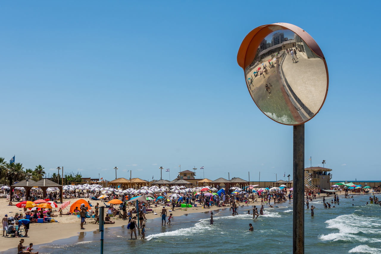Adult Beach Blue Clear Sky Crowd Day Large Group Of People Leisure Activity Lifestyles Mirror Nature Outdoors People Real People Sky Tel Aviv Tel Aviv Beach Vacations Water Women Live For The Story BYOPaper! The Great Outdoors - 2017 EyeEm Awards