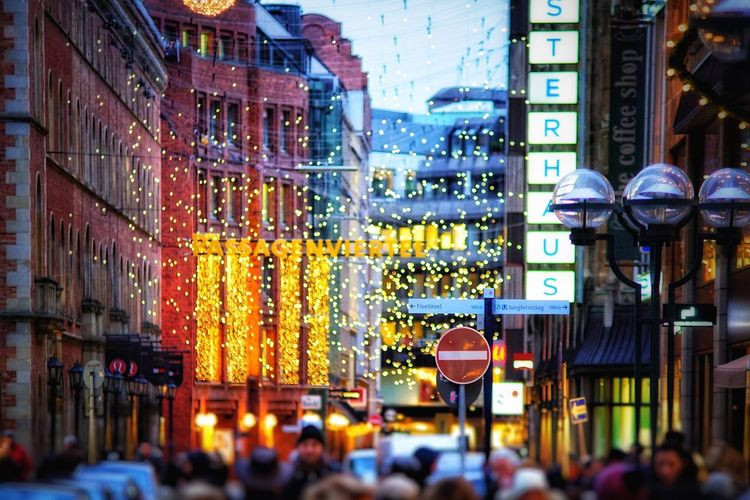 Shopping Street Christmas Decoration Shopping Street Building Exterior Architecture City Illuminated Large Group Of People Built Structure City Life Street Night City Street Outdoors Men Real People Store Crowd People Adult