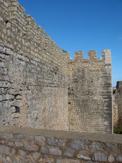 Ancient Architecture Blue Brick Wall Building Exterior Built Structure Clear Sky Day History Low Angle View Old Old Ruin Portugal Sky Stone Stone Material Stone Wall Sunlight The Past Wall Wall - Building Feature
