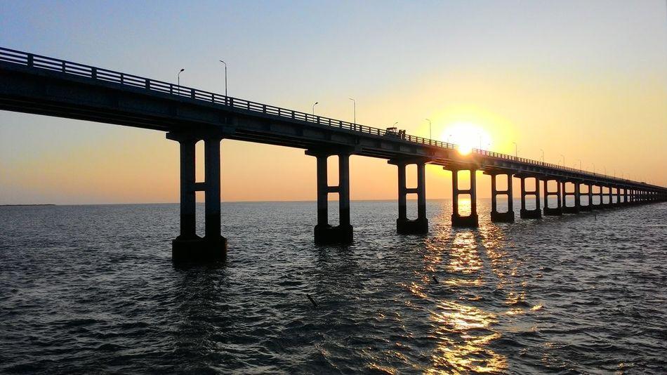 Pamban Road Bridge, Rameswaram Island, Tamil Nadu, India Sea Bridge Pambanbridge Second Journey Through Pamban Bridge Evening Sky Awe Inspiring Sunset In Backdrop Rameshwaram Island Tamilnadu India Solotrip