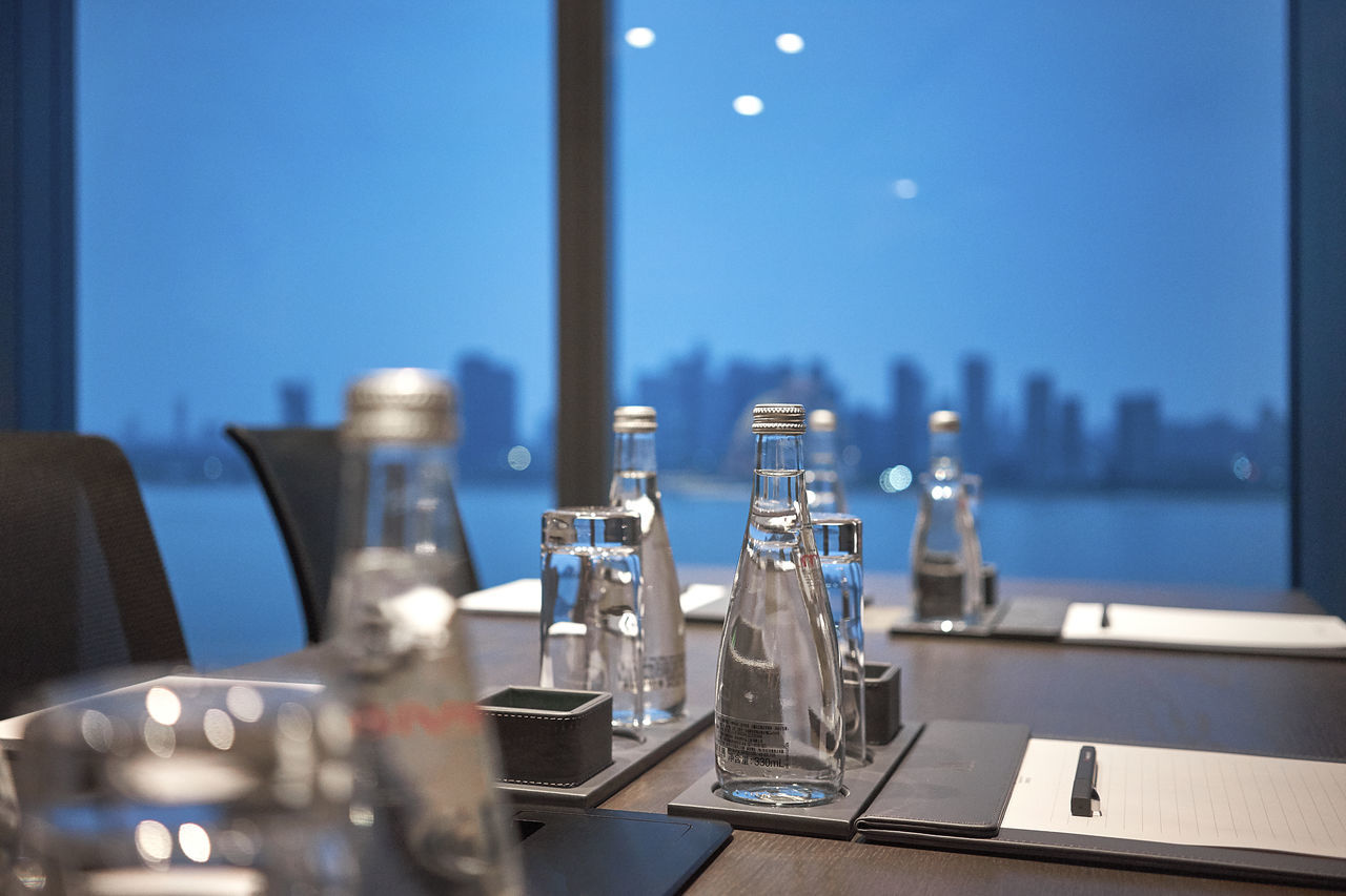 Meeting room setup with view on Hangzhou in China Blue Buisness Close-up Evian Focus Object Focus On Foreground Food And Drink Indoors  Interior Magic Hour Meeting Meetingroom Mineral Water Mood No People Office Office Chair Room With A View Selective Focus Skyline Table Twilight Water Window