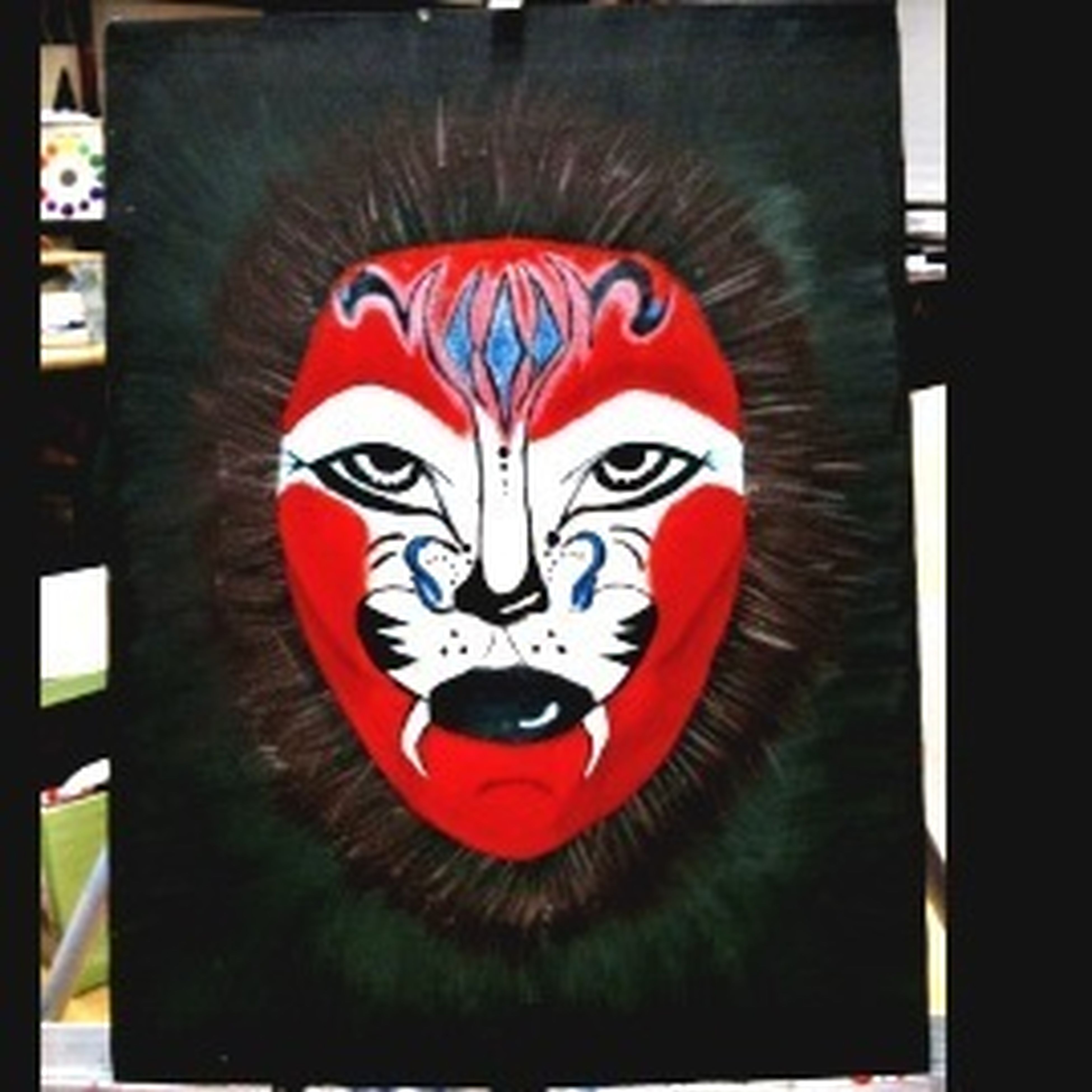 transfer print, creativity, art and craft, art, auto post production filter, close-up, indoors, red, animal representation, multi colored, human representation, no people, graffiti, day, front view, craft, animal head, design, animal themes