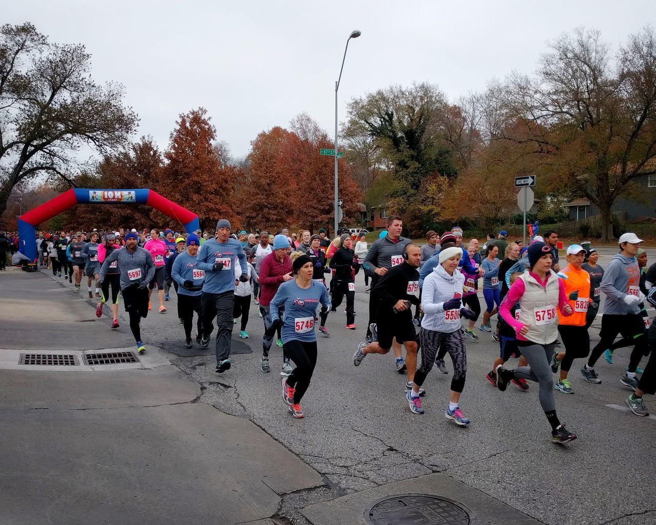 Runners start a 10k race. Large Group Of People Tree Women People Outdoors Run Running Race Fitness Multi Colored Day