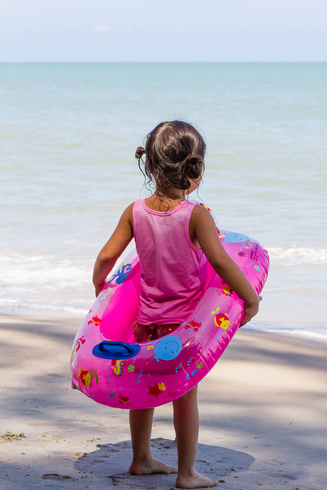 Little girl, big ocean Beach Beach Photography Beach Time Childhood Chilling Float From Behind Girl Horizon Over Water Looking Away Looking Out To Sea. Prepared Sea Take On The World Water Anticipation Waiting Ready Ready To Go