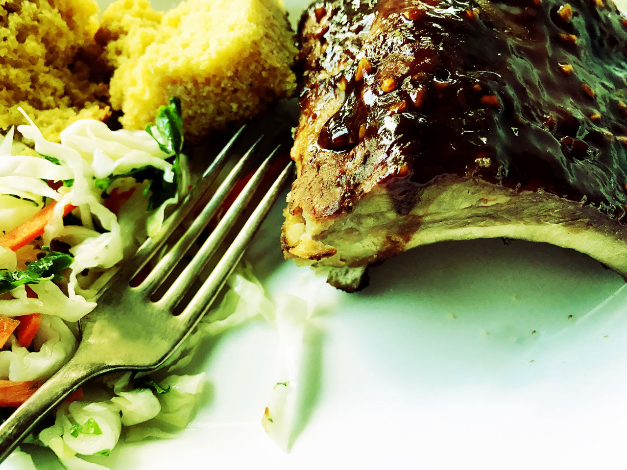 Barbecued rib dinner with copy space Baby Back Ribs Barbecue Sauce Barbecued Ribs Close-up Coleslaw Copy Space Cornbread Day Delicious Filtered Image Food Garlic Honey Indoors  Meat No People Phone Camera Pork Regional American Food Savory Food Serving Size Tasty Textures