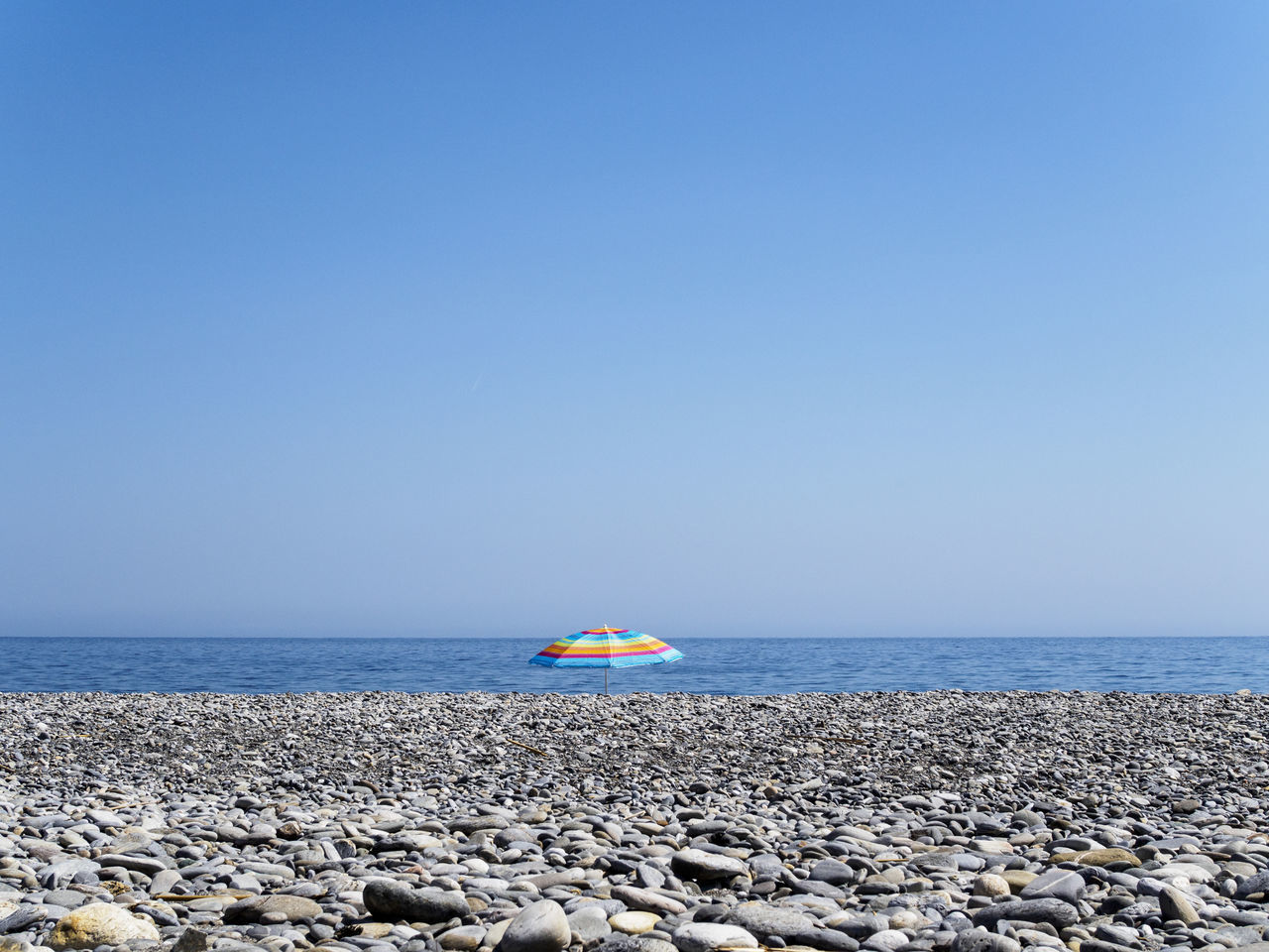 Sougia beach on the south side of Crete Beach Blue Holiday Horizon Over Water Minimalism No People Pebble Pebble Beach Sea Sky Tranquil Scene Tranquility Umbrella Vacations Water