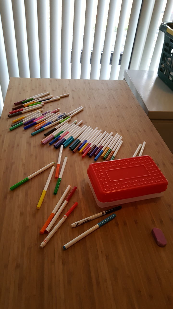colored pencil, wood - material, indoors, large group of objects, pencil, multi colored, table, variation, high angle view, no people, choice, crayon, close-up, desk organizer, day