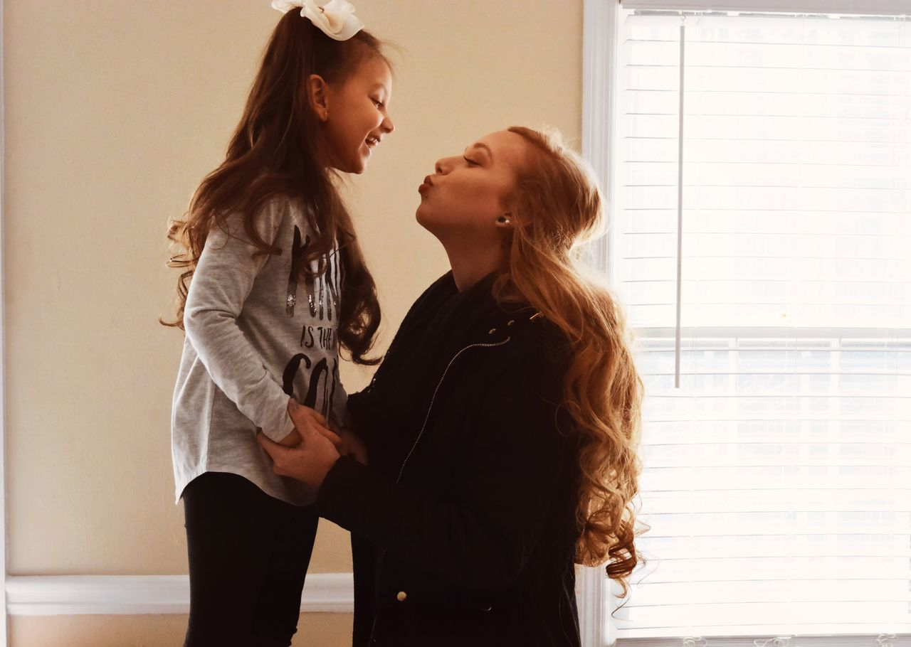 Mother Daughter Two People Bonding Pregnant Lifestyles Young Women Indoors  Love Real People Home Interior Women Standing Affectionate Togetherness Young Adult Domestic Life Leisure Activity Friendship Adult Adults Only People