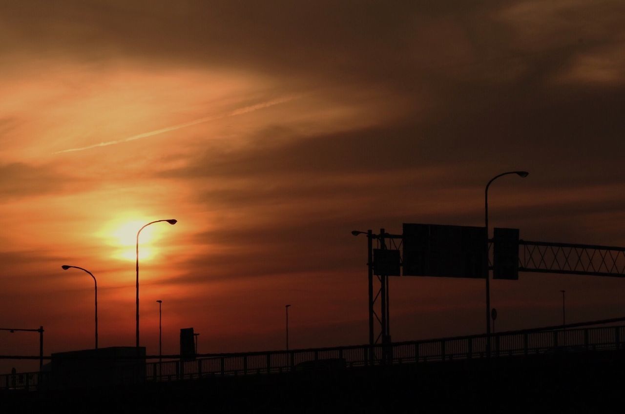 Sunset Street Light Sky Silhouette Dramatic Sky Nature No People Cloud - Sky Outdoors Scenics Beauty In Nature Day