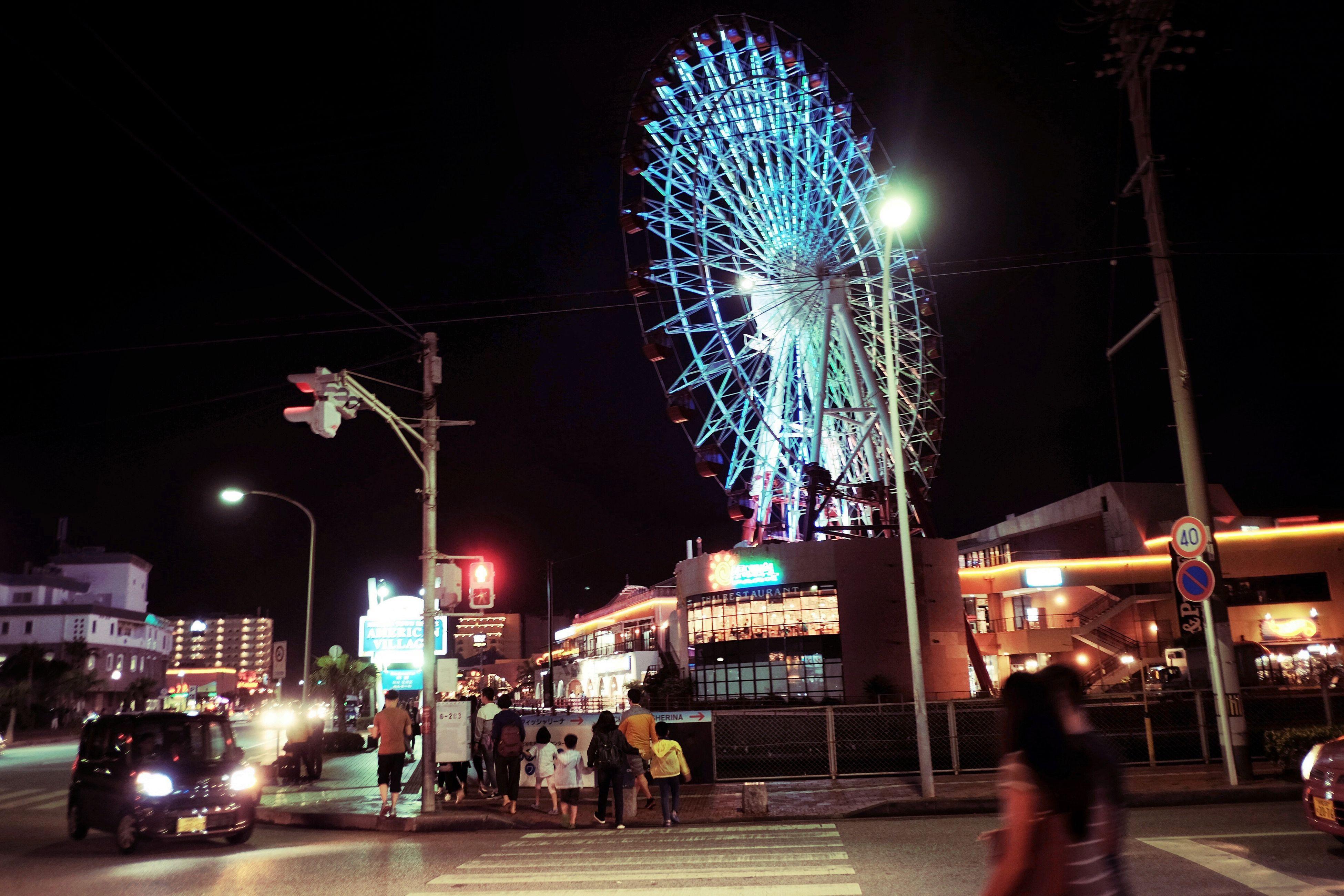 night, illuminated, city, built structure, city life, lighting equipment, lifestyles, street light, leisure activity, sky, outdoors, city street, glowing, travel destinations