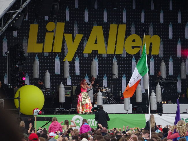 Baby Bottles Camera Man Colorful Crowd At Front Of Stage Festival Season Glastonbury 2014 Lily Allen Multi Colored Sign Yellow