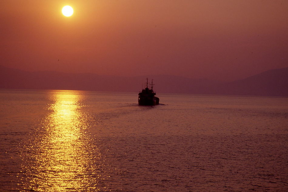 sailing2 Beauty In Nature Greece Horizon Over Water Mode Of Transport Nature Nautical Vessel No People Orange Color Outdoors Patriotism Sailing Sailing In The Sunset Scenics Sea Sky Sunset Tranquil Scene Tranquility Transportation Water Waterfront