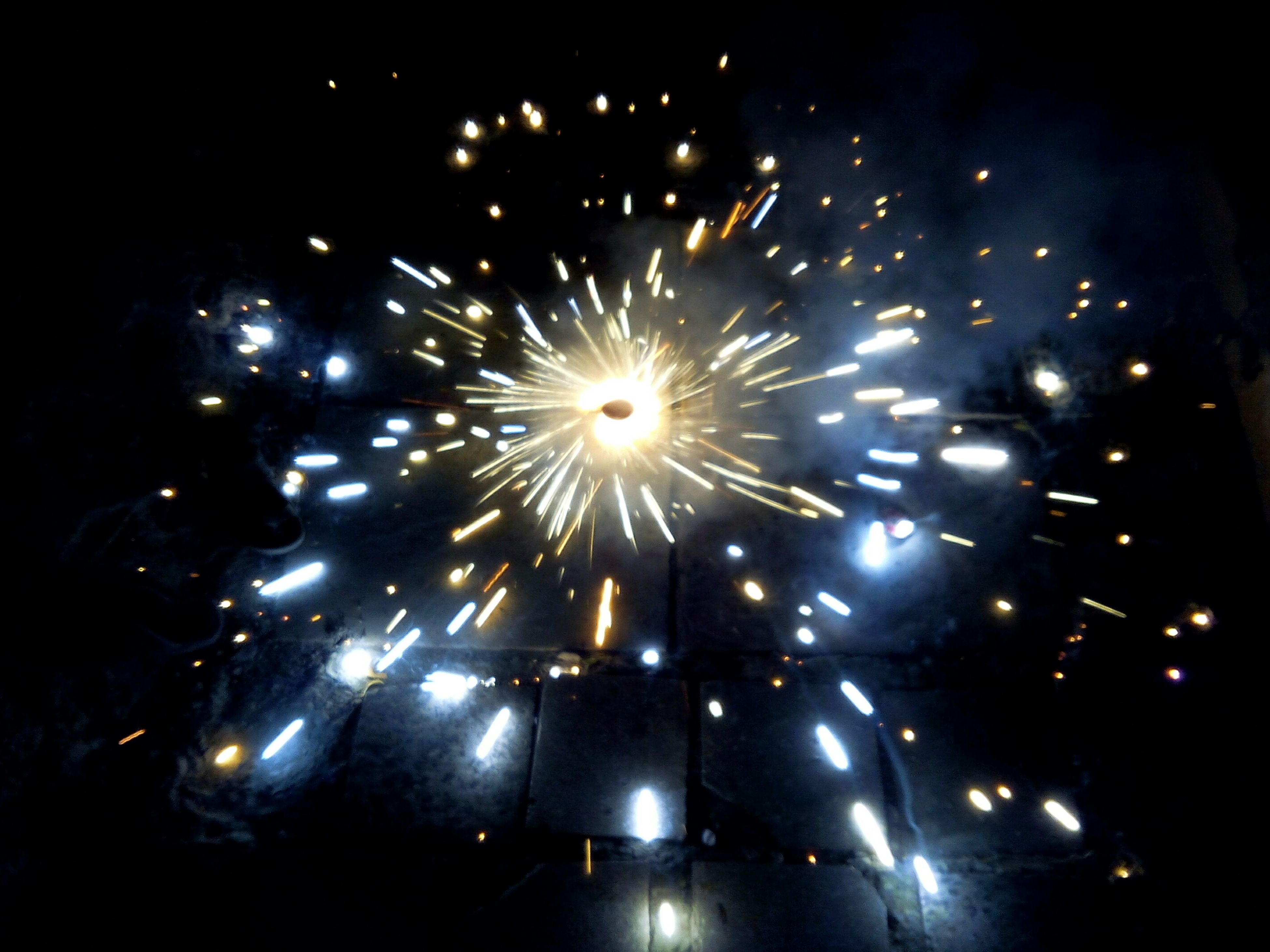 night, illuminated, firework display, glowing, celebration, exploding, long exposure, firework - man made object, sparks, arts culture and entertainment, firework, event, motion, low angle view, lighting equipment, celebration event, dark, blurred motion, entertainment, light - natural phenomenon