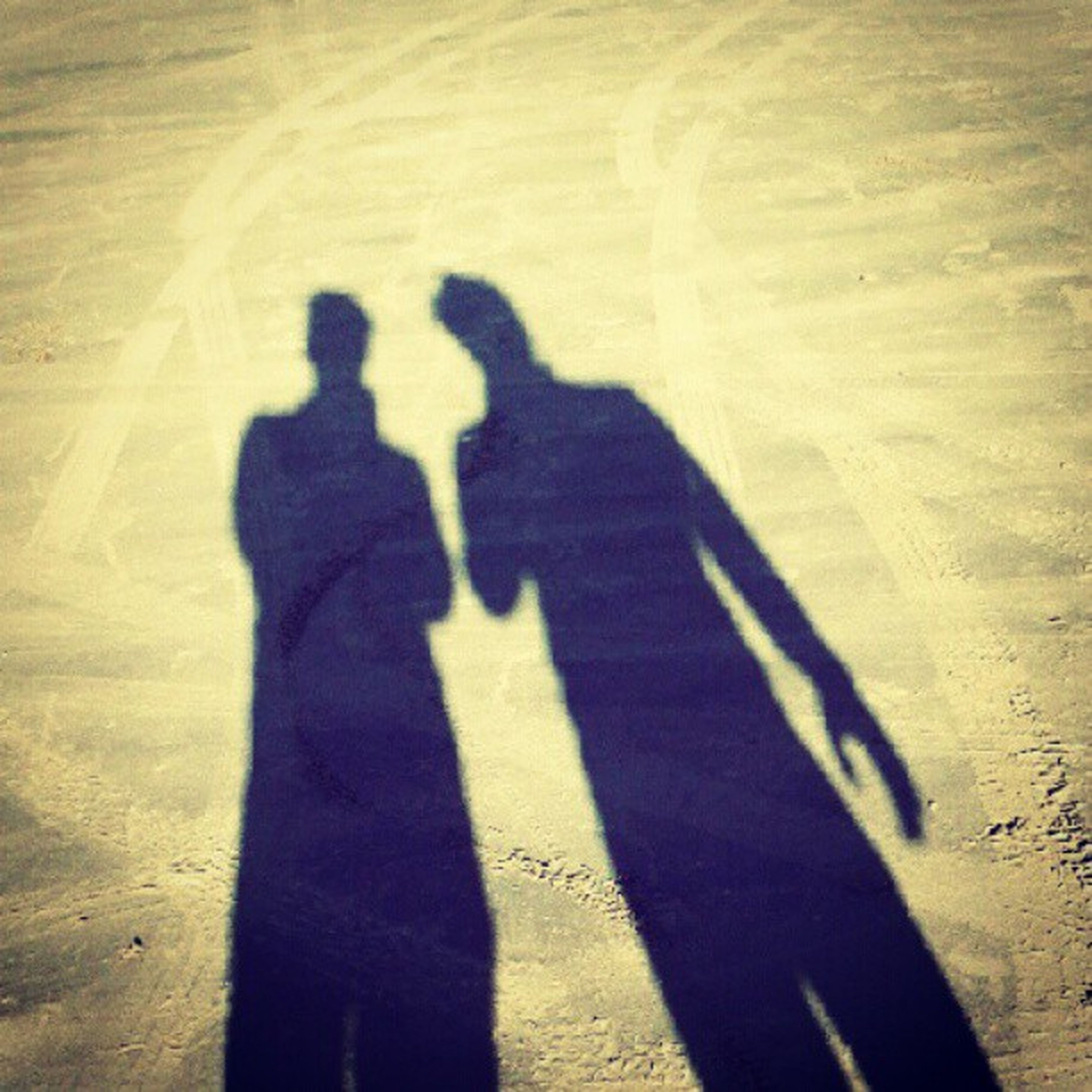 shadow, focus on shadow, lifestyles, sunlight, men, leisure activity, high angle view, togetherness, bonding, silhouette, love, standing, unrecognizable person, person, outline, outdoors, day