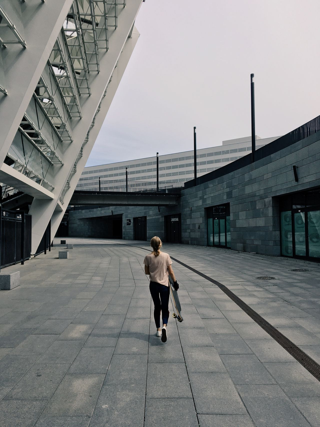 Architecture Built Structure Casual Clothing City City Life Day Diminishing Perspective Full Length Leisure Activity Lifestyles Outdoors Skateboarding Sky The Way Forward Vanishing Point Walkway