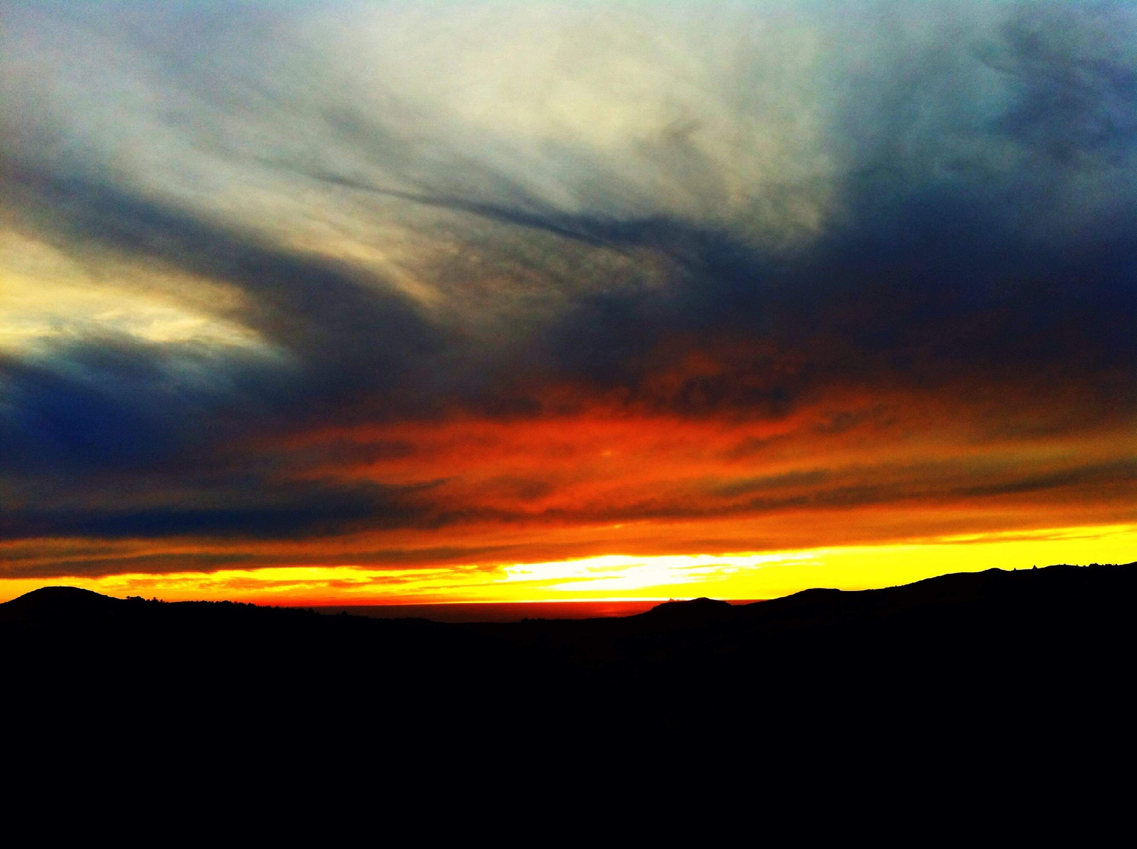 sunset, scenics, silhouette, tranquil scene, sky, beauty in nature, tranquility, orange color, cloud - sky, idyllic, dramatic sky, nature, landscape, cloud, mountain, majestic, cloudy, moody sky, atmospheric mood, outdoors