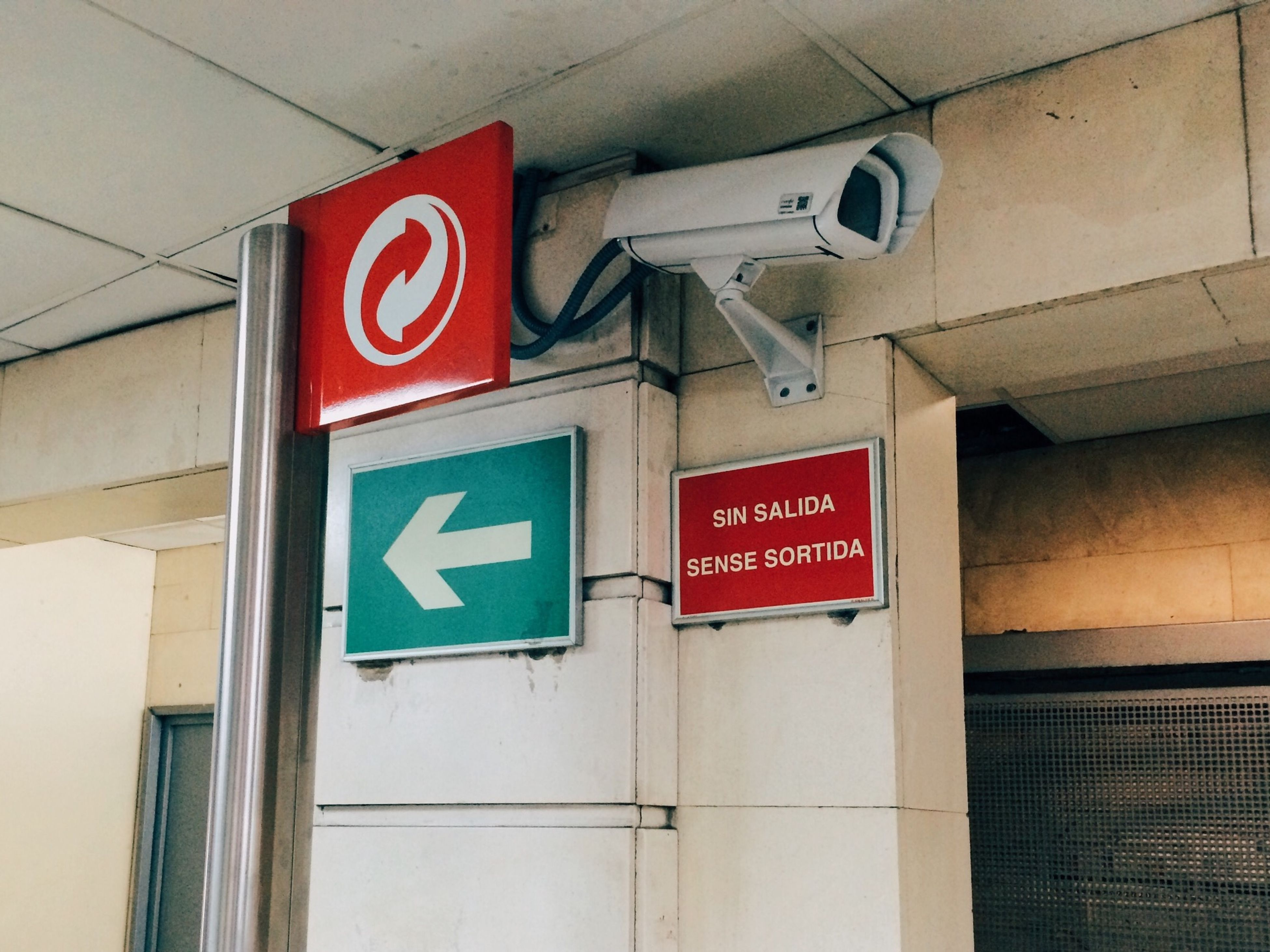 text, communication, western script, guidance, information sign, sign, architecture, information, built structure, building exterior, directional sign, non-western script, low angle view, road sign, capital letter, arrow symbol, transportation, direction, red, warning sign