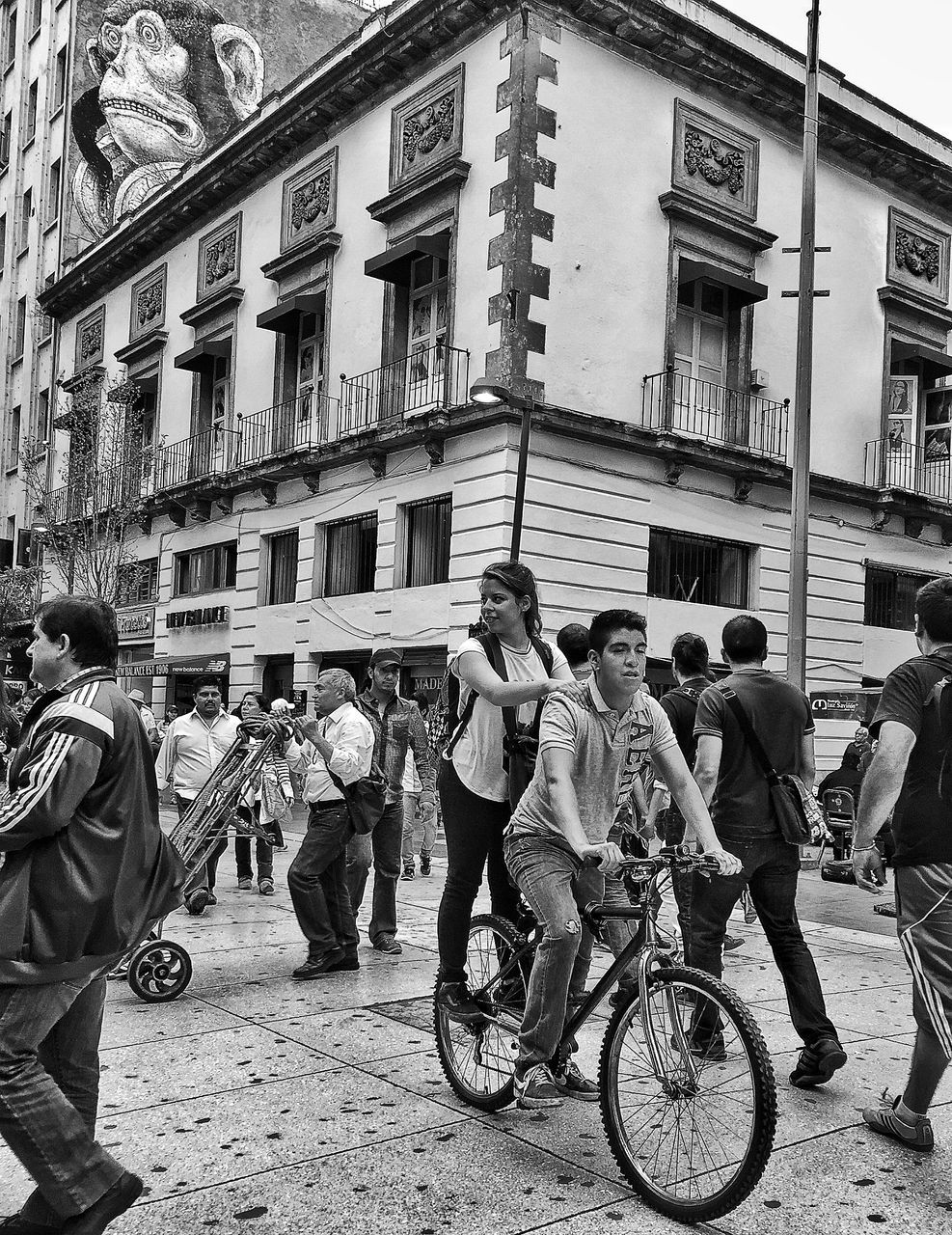 building exterior, architecture, built structure, large group of people, men, real people, street, women, day, city life, outdoors, city, transportation, bicycle, protestor, sky, adult, people, adults only