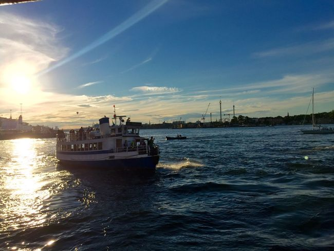 Transportation Nautical Vessel Water Waterfront Mode Of Transport Boat Calm Cloud Sky Sea Tranquility Tranquil Scene Scenics Rippled Sun Ocean Nature Blue Sunbeam Beauty In Nature