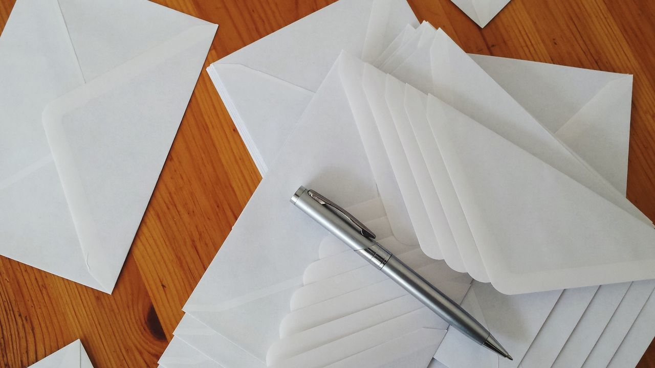 Beautiful stock photos of envelope, Directly Above, Envelope, Indoors, Large Group Of Objects