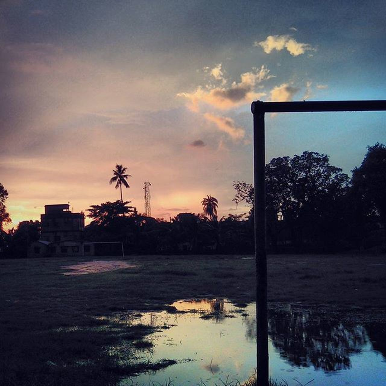 tree, reflection, sky, sunset, sport, soccer, water, outdoors, cloud - sky, no people, soccer field, nature, goal post, day