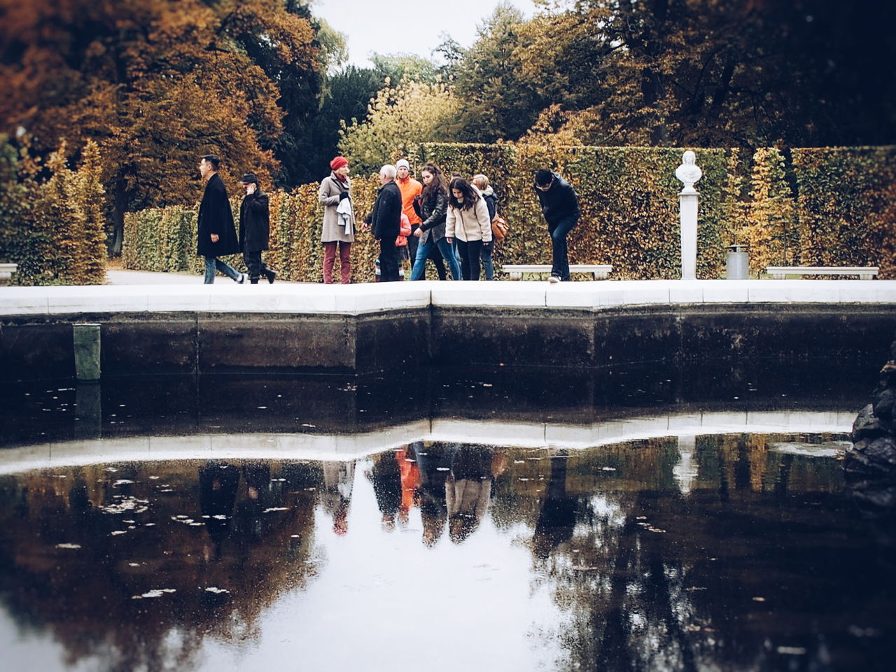 Down on the upside... Real People Lifestyles Reflection Leisure Activity Water Adult Outdoors Tree Adults Only Men Day People Friendship Women Togetherness Nature Autumn Autumn Colors Water Reflections Tourism Tourists Happy Cheerful Life Streetphography Peoplephotography