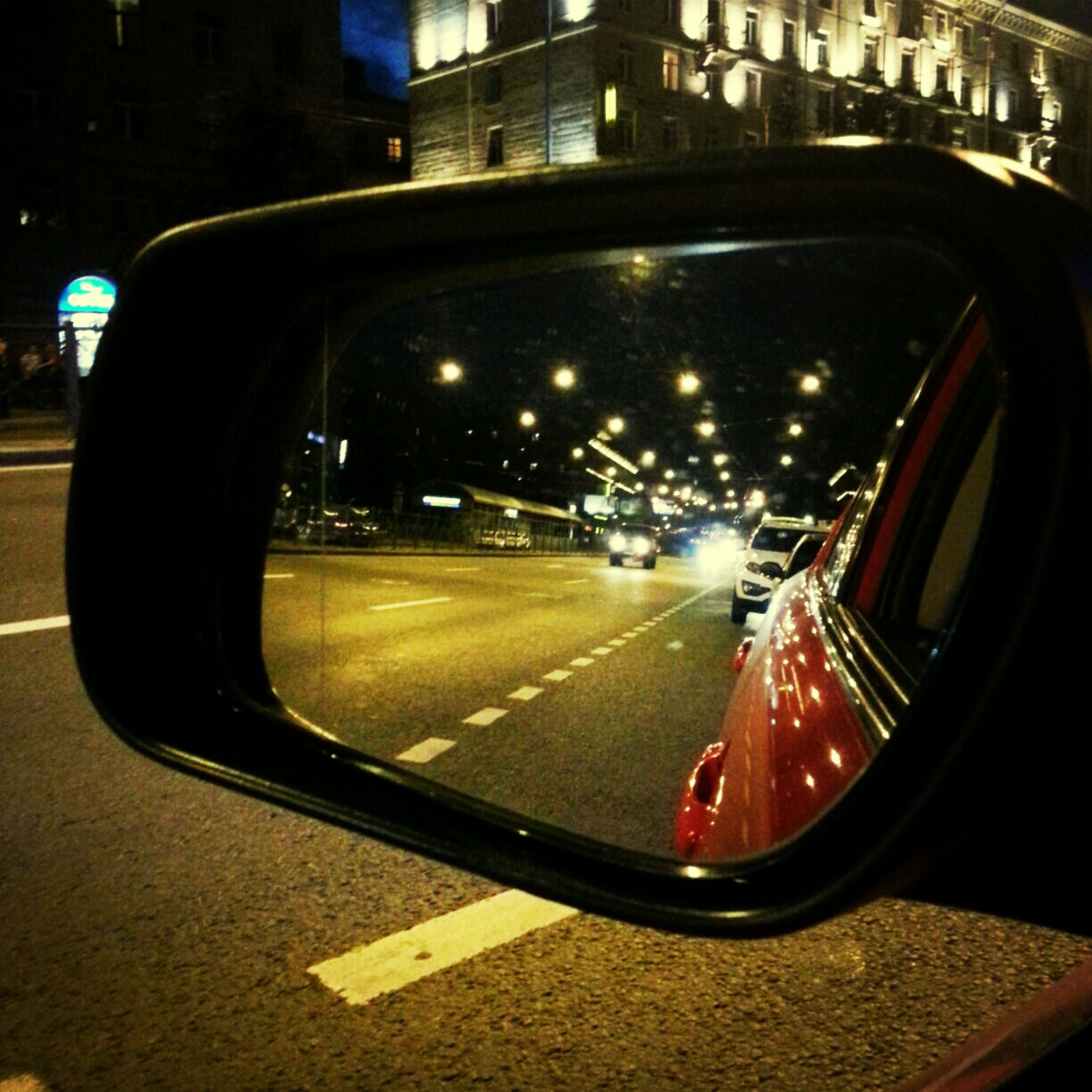 transportation, mode of transport, land vehicle, car, headlight, street, road, illuminated, city, night, travel, traffic, glass - material, side-view mirror, on the move, tail light, reflection, car interior, building exterior, vehicle interior