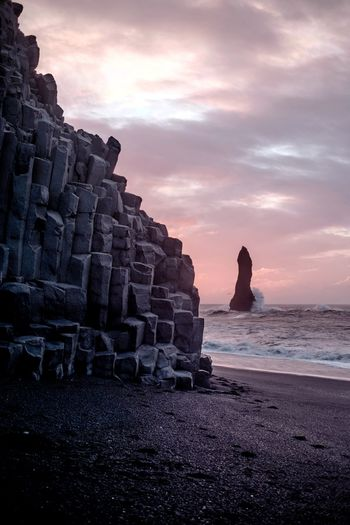 Monument (Find me on IG @noeldxng) Sunset Travel Destinations Beach Rock - Object Landscape Tranquility Cloud - Sky No People Water Outdoors Scenics Beauty In Nature Perspectives On Nature Be. Ready. Adventure The Week On EyeEm Beauty In Nature Rural Scene Iceland Black Sand Beach Sand