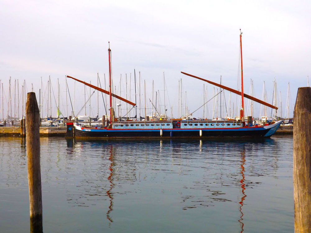 Boats⛵️ Chioggia, Italy Distant Engineering Harbor Mode Of Transport Multi Colored Nautical Vessel No People Reflection Scenics Sea Sky Tourism Tranquil Scene Tranquility Transportation Travel Destinations Vacations Water Waterfront