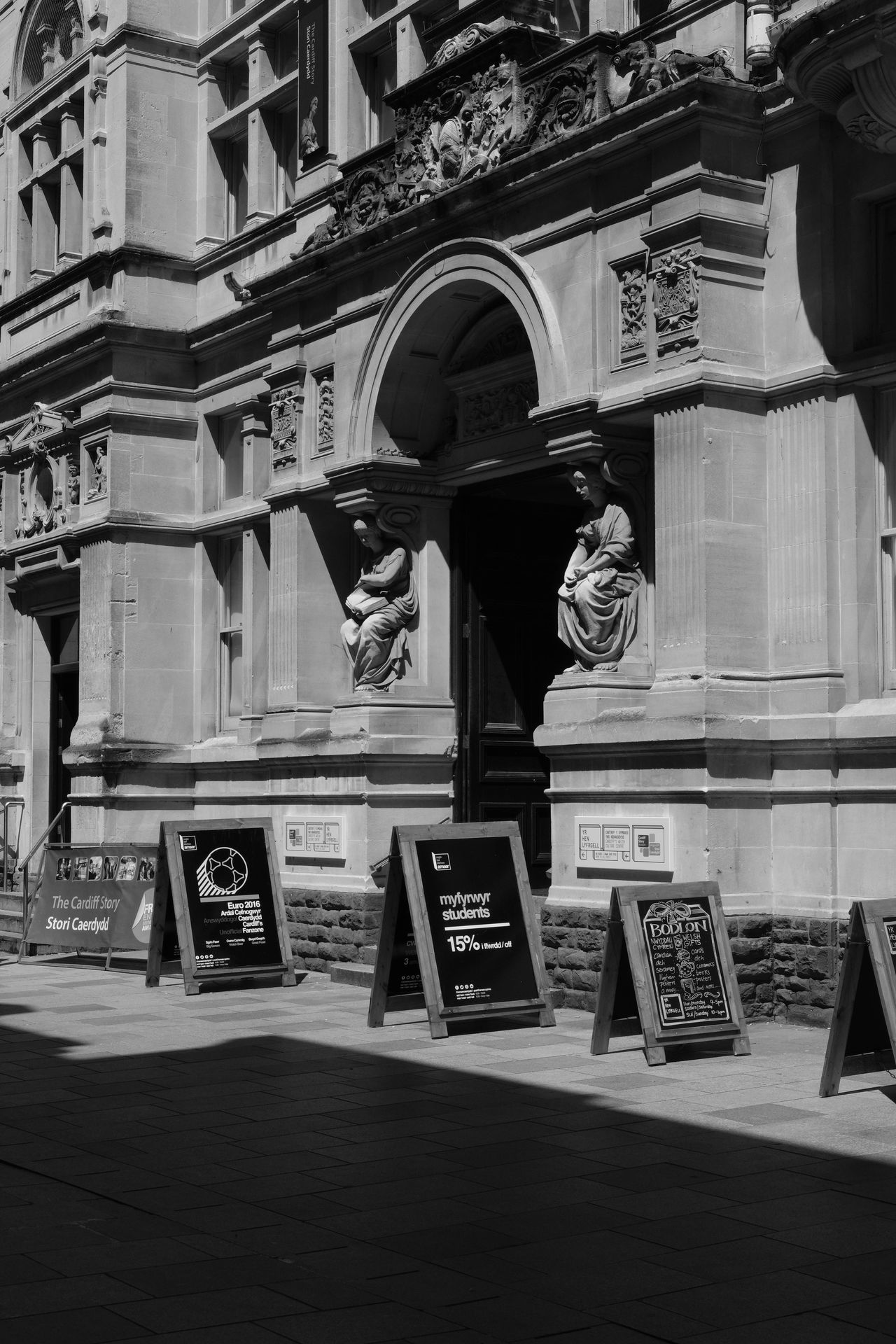 Architectural Column Architecture Black & White Building Built Structure Cardiff City City Life Day Doorway Façade Museum No People Outdoors Sculpture Shadow Signs The Cardiff Story The Old Library