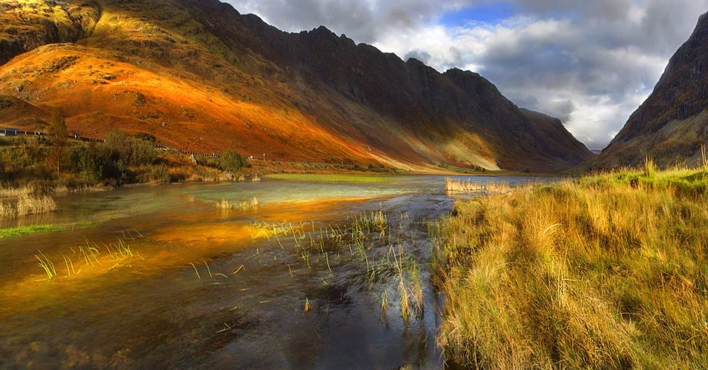 Loch Achtriochtan, Glencoe Scotland. Reflection Mountain Lake Water Scenics Cultures Beauty In Nature Nature Grass Tranquility Landscape Mountain Range No People Outdoors Tree Sky Day