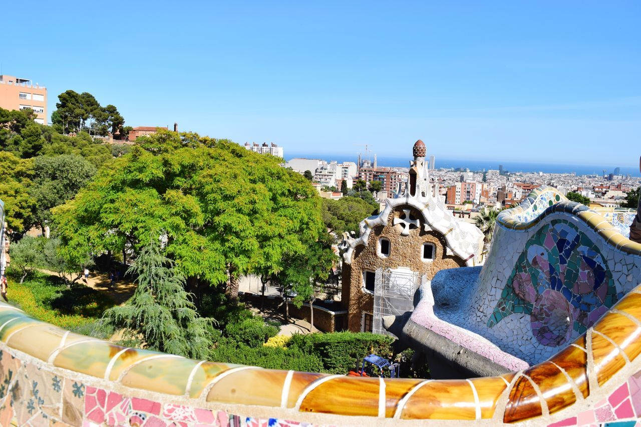 Park Guell Barcelona Architecture Building Exterior Built Structure Tree City Tourism Tourist Attraction  Travel Destinations Gaudi Design Art High Angle View No People Outdoors Clear Sky Sunlight Nature Water Cityscape Sky Colorful Colorful City