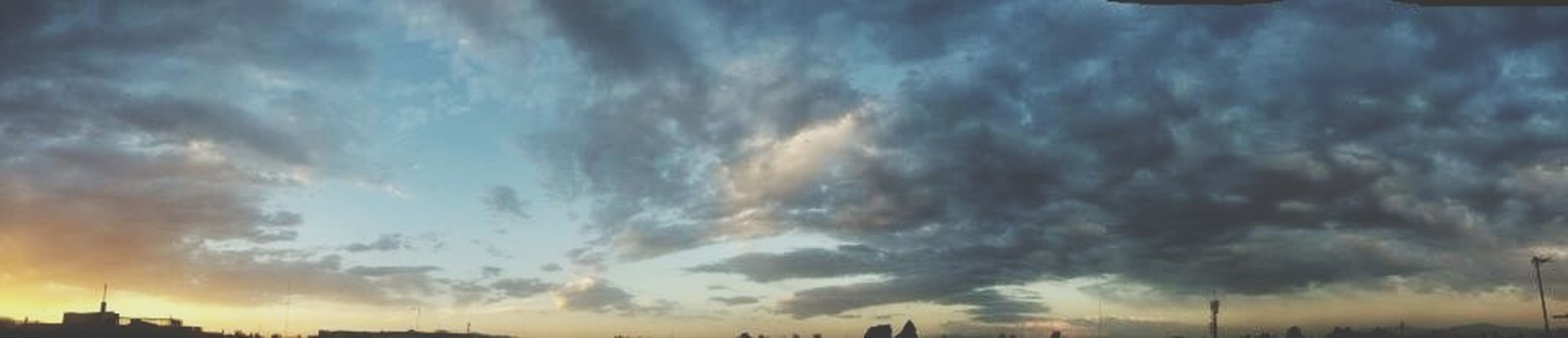 sky, cloud - sky, cloudy, sunset, silhouette, weather, beauty in nature, scenics, cloud, tranquility, nature, low angle view, dramatic sky, overcast, tranquil scene, building exterior, cloudscape, dusk, storm cloud, built structure