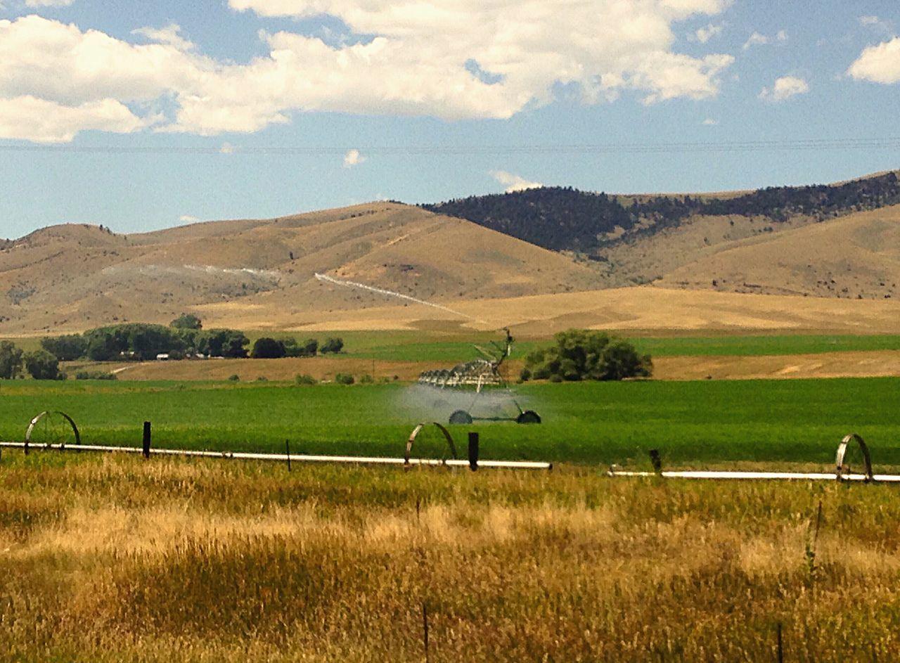 Scenic farmland Scenic Farmland Scenic Drive Road Trip Farm Equipment Water System Water Spray Sprinkler Mountains Trees Montana Colour Of Life Eyeemphoto