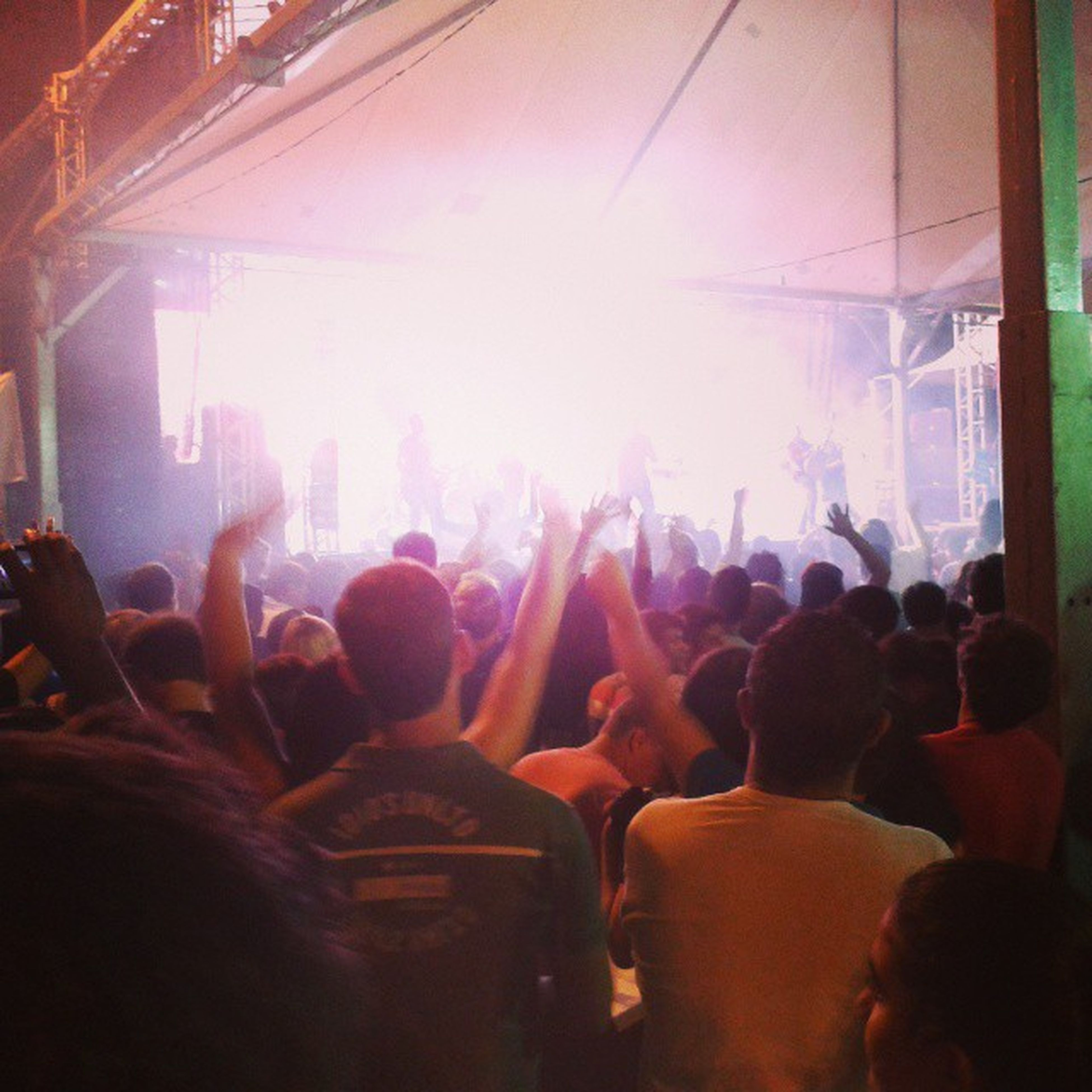 large group of people, crowd, men, lifestyles, person, leisure activity, illuminated, arts culture and entertainment, nightlife, event, enjoyment, music, performance, music festival, concert, indoors, popular music concert, togetherness