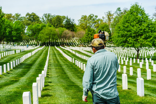 Arlington National Cemetery Casual Clothing Day Full Length Grass Graveyard Graveyard Beauty Green Color Growth Lawn Lawnmower Leisure Activity Lifestyles Military Mower Outdoors Paris Rear View Sky Soldiers Spring Tree Up Close Street Photography Washington, D. C. Worker